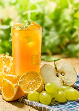 Photo for Juice, orange, apple, grape and lemon on the wood table, outdoor shot - Royalty Free Image