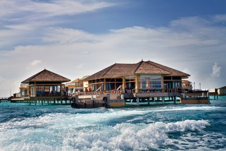 Island in ocean, overwater villa with endless swimming pools. Ma