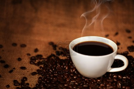 Photo for Coffee cup on roasted coffee beans - Royalty Free Image