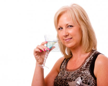 Portrait of pretty middle-aged woman in her 40s with cocktail and dressed for party or night out on the town