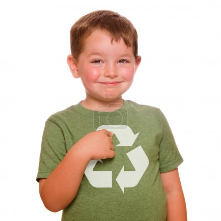 Recycling for the future concept with smiling child proudly pointing at recycling logo on his green t-shirt