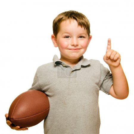 Foto de Niño con fútbol celebrando demostrando que él es el número 1 aislado en blanco - Imagen libre de derechos