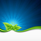 Green leaves ecology on lighting blue background