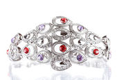 Beautiful silver bracelet with precious stones isolated on white