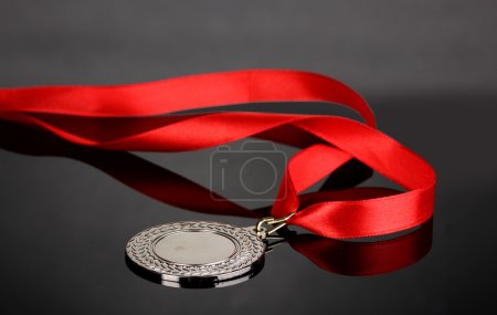 Silver medal on grey background