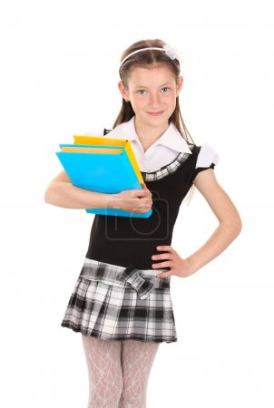 Beautiful little girl in school uniform with books isolated on white