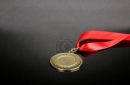 Gold medal on grey background
