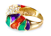 Beautiful gold ring with precious stones isolated on white