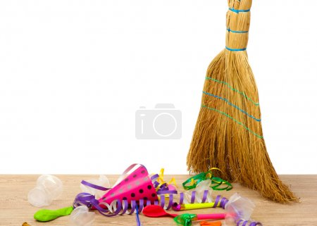 Photo for Broom sweep the trash after a party on white background close-up - Royalty Free Image