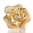 Golden ring with gold flower and clear crystals is...