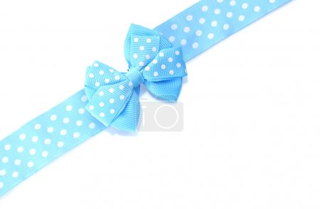 Beautiful blue bow and ribbon isolated on white