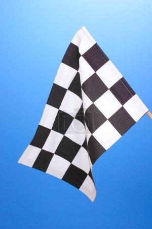 Checkered finish flag on blue background
