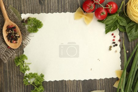 Photo for Paper for recipes vegetables, and spices on wooden table - Royalty Free Image