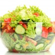 Fresh vegetable salad in transparent bowl isolated...