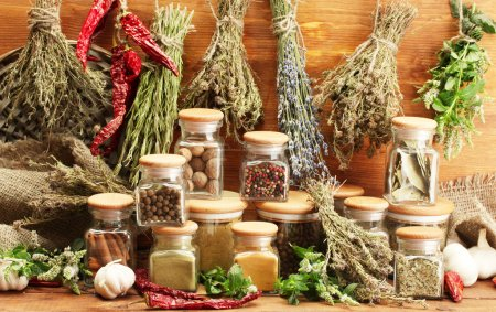 Photo for Dried herbs, spices and and pepper, on wooden background - Royalty Free Image