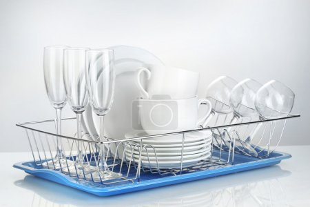 Clean dishes on stand isolated on white