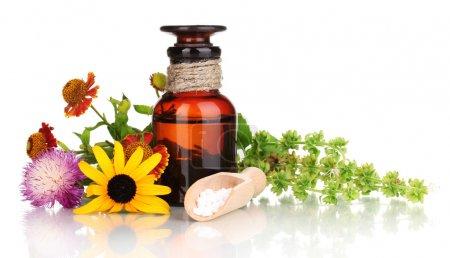 Photo pour Flacon de médicament avec comprimés et fleurs isolés sur blanc - image libre de droit