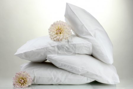 Photo for Pillows and flowers, on grey background - Royalty Free Image