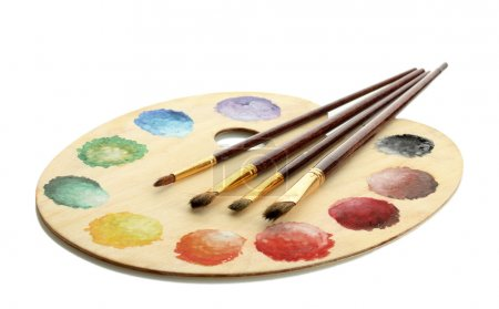 Photo for Wooden art palette with paint and brushes isolated on white - Royalty Free Image
