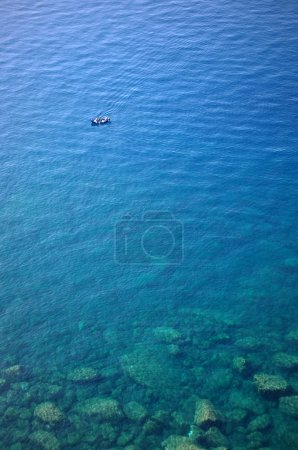 Photo for Boat in deep blue water view from above - Royalty Free Image