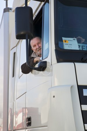 Truck driver and his truck.