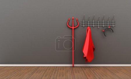 Illustration of devil costume and horns on a hange...