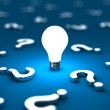 Many questions with one lightbulb on a blue backgr...