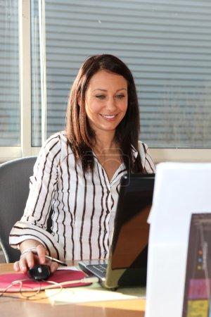 Brunette working at her desk