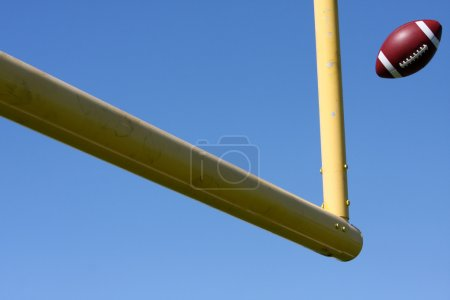 Football kicked through the Goal Posts