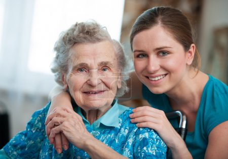 Photo for Senior woman with her caregiver at home - Royalty Free Image