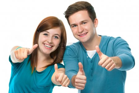 Photo for Happy teens showing thumbs up - Royalty Free Image