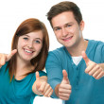 Happy teens showing thumbs up...