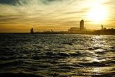 Sundown seascape with Barcelona on the background