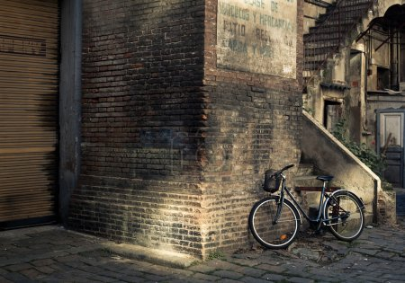 Bicycle under the wall