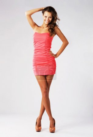Gorgeous happy model in pink gown