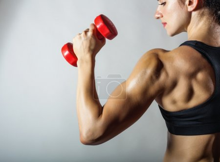 Fitness woman with barbells