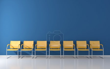Photo for Yellow stools on blue wall in the waiting room - Royalty Free Image