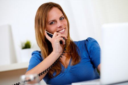 Pretty lovely woman smiling on phone