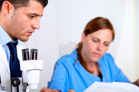 Two colleagues working at laboratory