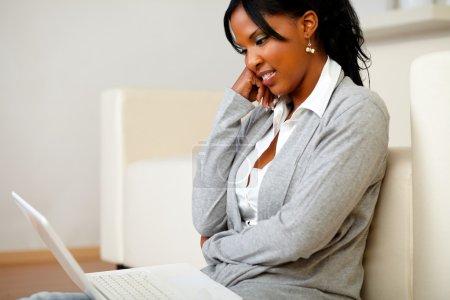 Charming black woman sitting on the floor