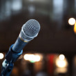 Close up of microphone 1n concert hall or conferen...