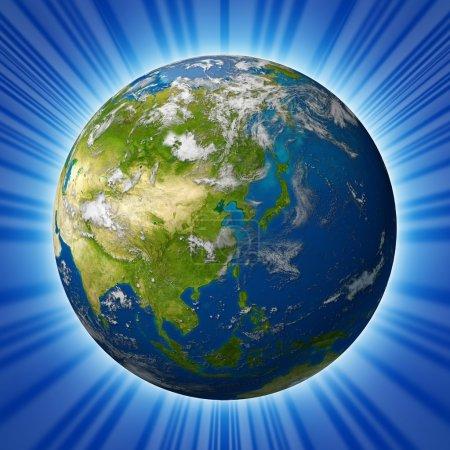 Photo pour Planète modèle terrestre représentant le continent asiatique, y compris la Chine, le Japon, la Corée et l'Inde entourée d'un océan bleu et de nuages isolés sur un fond radial . - image libre de droit