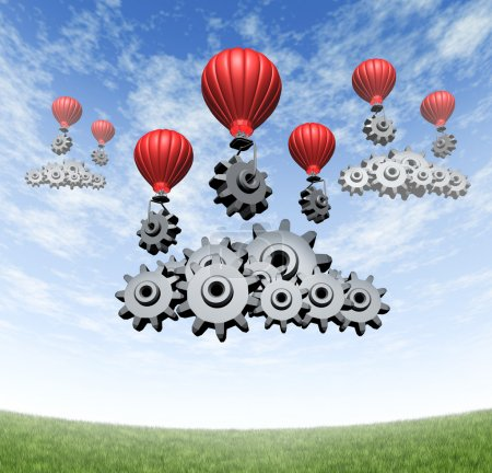 Photo for Wireless technology business concept and building an internet mobile cloud computing network with red hot air balloons with gears and cogs creating data server clouds on a blue summer sky and green grass. - Royalty Free Image