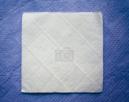 Paper napkin on blue napkin background