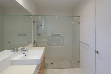 Photo for Simple bathroom with shower, sink and mirror - Royalty Free Image