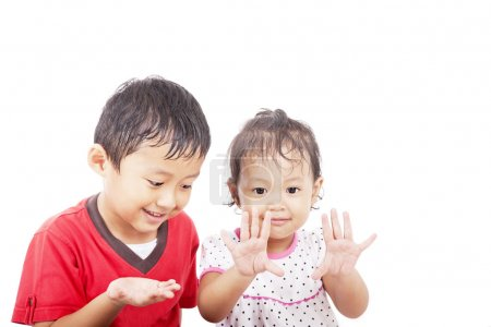 Cheerful asian siblings