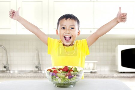 Pleased child with salad