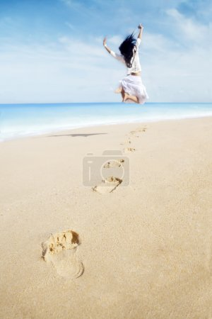 Photo for Portrait of woman with footprint enjoying freedom on beach. shot at tropical beach - Royalty Free Image