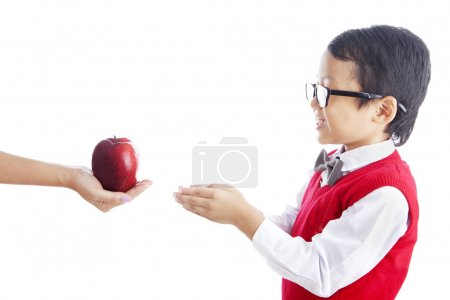 Schoolchild getting apple