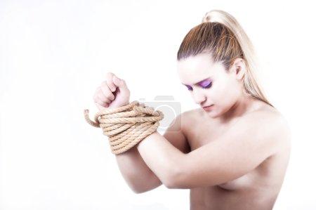 Beautiful bemale model tied
